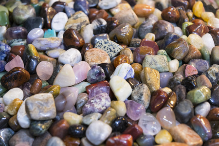 Background of colored stones of ordinary and semi-precious Stock Photo