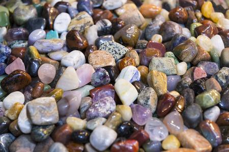 Background of colored stones of ordinary and semi-precious Banco de Imagens - 91007810