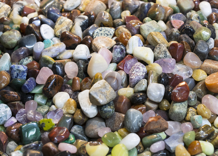 Background of colored stones of ordinary and semi-precious Banco de Imagens