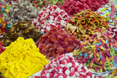 Assortment of jellied colored sweets as a product background