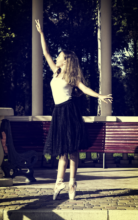 Girl is engaged in a ballet in the park