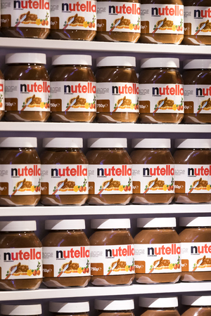 TEL AVIV, ISRAEL - 26 NOVEMBER 2017: Background with cans of chocolate nutty pasta Nutella attractions of the city Market Sarona.