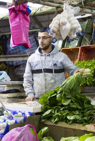 TEL AVIV, ISRAEL - 21 NOVEMBER 2017: Sellers on the old grocery street Nahalat-Benjamin