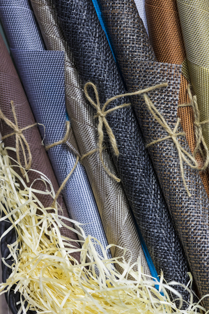 Rolls of wrapping paper binding with rope Stockfoto