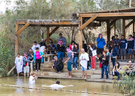 BETHABARA, ISRAEL- 25 NOVEMBER 2017: Pilgrims from different countries accept the rite of baptism in the Jordan River in Israel