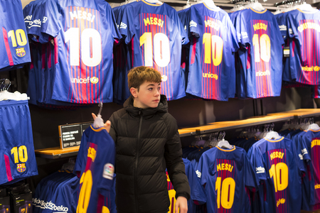 BARCELONA, SPAIN - 12 JANUARY 2018: Official Store FC Barcelona, clothing and footwear team of souvenirs and paraphernalia for fans of the team and visitors of the stadium.