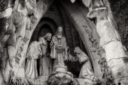BARCELONA, SPAIN - 13 JANUARY 2018: Black and white image elements of architecture and statues of the entrance to the old part of the Sagrada Familia.