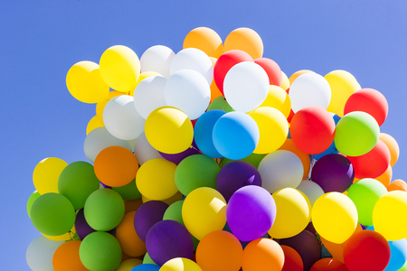 Background of a set of colored balloons on the sky background