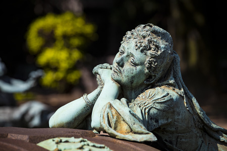5 JUNE 2018, MILAN, ITALY: Statues of mourning at the graves of the monumental cemetery in Milan.