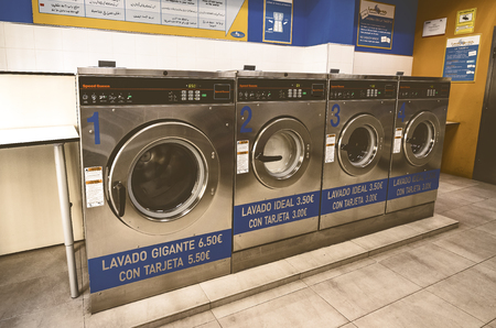 MADRID, SPAIN - 27 MARCH, 2018: Public laundry with mashinam for a street in the city of Madrid.