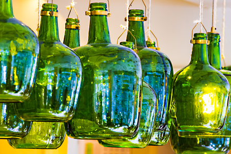Lamps from old wine bottles against the ceiling