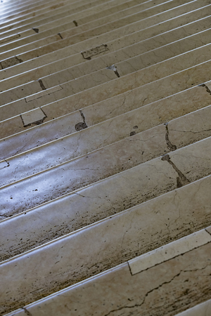 Background of old cracked marble stairs close-up
