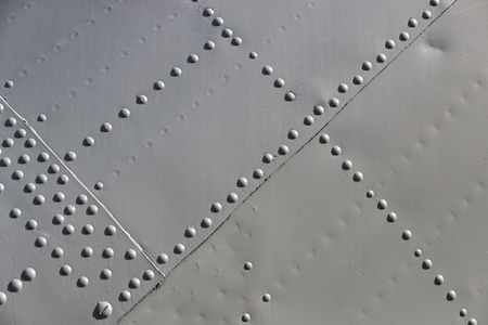 The texture of the metal of military equipment close-up shot.