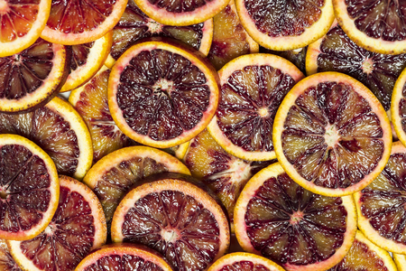 Background from sliced citrus oranges grapefruit lemon. Imagens