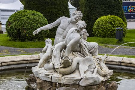 Statues of the fountain on the square of Empress Maria Theresa in the city of Vienna.