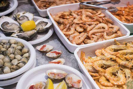 Seafood on a plastic plate shrimp scallops Reklamní fotografie