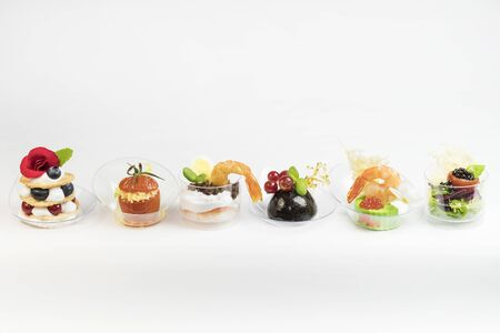 Mini canapes for refreshments at banquets receptions catering on a white