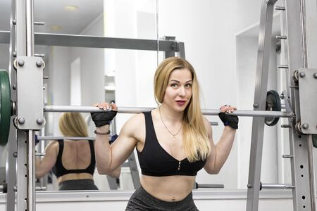 A young girl is engaged in power fitness in the gym