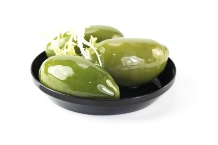 Mini snacks for buffet and banquet in a plastic bowl on a white background.