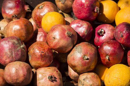 Background iz fruit ripe pomegranates shot closeup Stock Photo