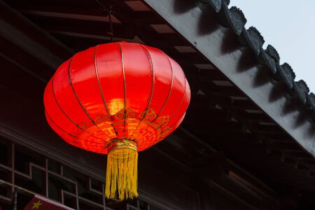 Asian lantern near national building decoration elements.