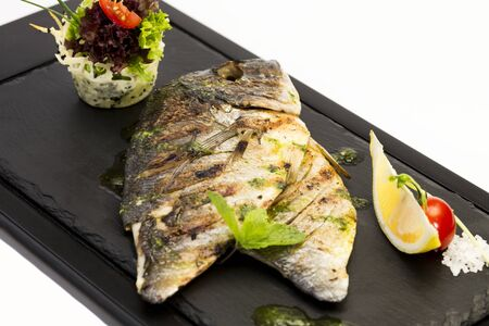Grilled sea fish isolated on a white