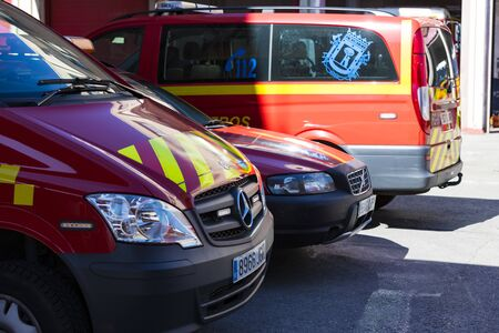 MADRID, SPAIN - 26 MARCH, 2018: Garage of cars and equipment of the city fire department. Редакционное