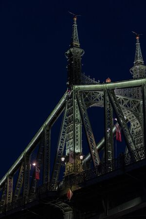 BUDAPEST, HUNGARY. JUNE 23, 2017: Elements of architecture of the night city of Budapest from the Danube River.
