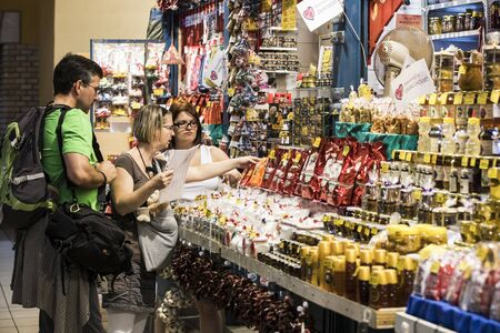 BUDAPEST, HUNGARY - JULY 17, 2017: The big central market of Budapest, a place of visiting of tourists for purchases of sausages of a paprika of souvenirs.