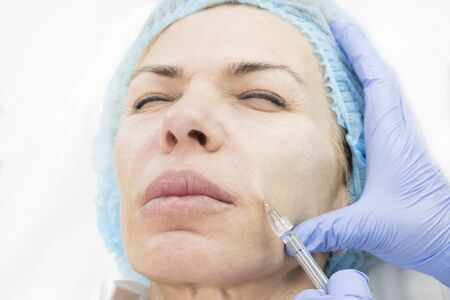 The procedure of therapeutic injections to rejuvenate the skin and smooth wrinkles.