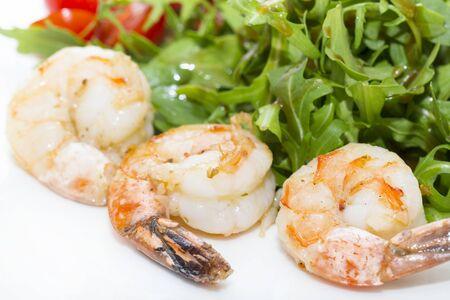 Shrimp and arugula salad close up shot in a restaurant.