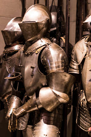 4 JUNE 2018, MILAN, ITALY: Museum of the Poldi Pezzoli Knights' Hall with samples of medieval weapons and ammunition
