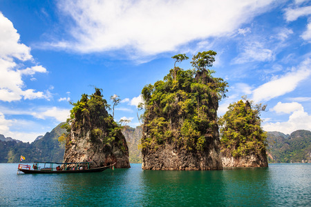 sok: Three rocks in Cheow Lan Lake, Khao Sok National Park, Thailand.  Three rocks in Cheow Lan Lake, Khao Sok National Park, Thailand.