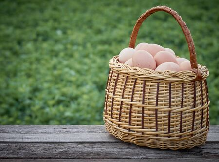 Chicken eggs in a basket.