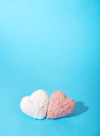 Handmade craft hearts on blue background. Stock Photo