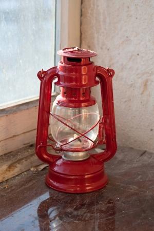 windowsill: kerosene lamp on the windowsill