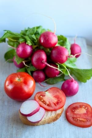fascicle: tomato and garden radish, open sandwich vitamins Stock Photo