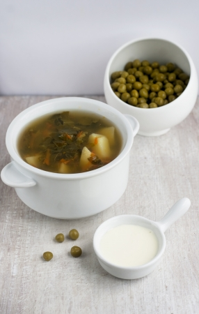 green soup in the white china plate and  preserved peas photo