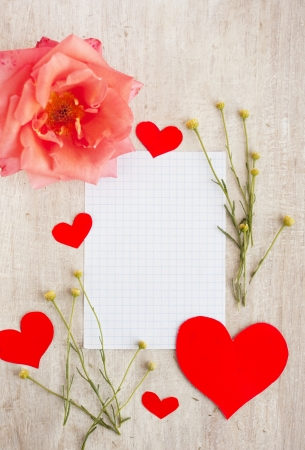 paper for writing, pink rose and red hearts photo