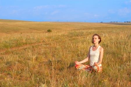 beatitude: slender beautiful woman meditate outdoors