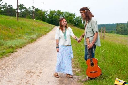 couple hitchhiker happy hippie in love with guitar on the road  photo