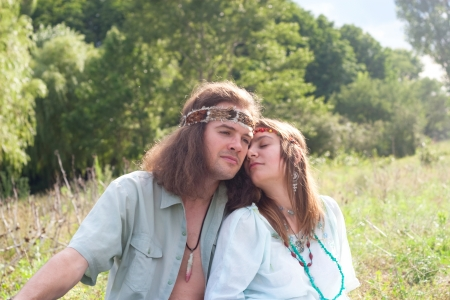 enamoured: couple young enamoured hippie on the meadow