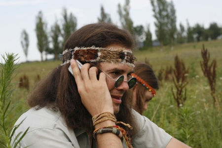 young hippie men speak on the mobile phone photo