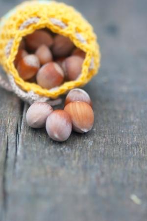 crocheted yellow bag with hazelnut - autumnal  present Stock Photo - 23033628