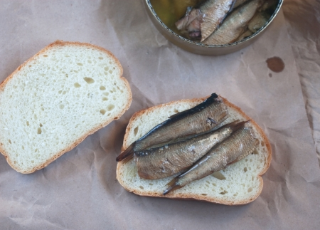 sprats: open sandwich with sprats on the paper Stock Photo