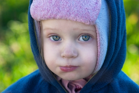masticate: face touching big-eyed child in the cap and hood