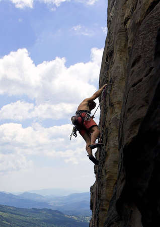 Climber on a vertical rock Stock Photo - 2336864