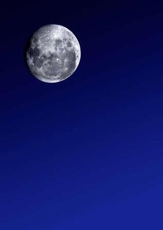 Full moon image, on graduated blue background photo
