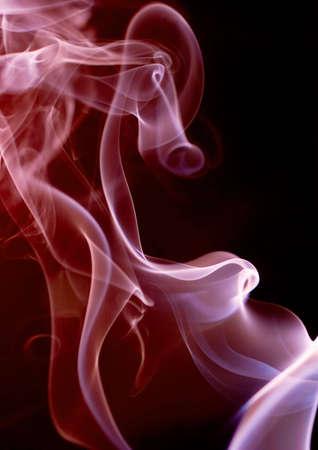 Smoke on a dark background, with magenta tint Stock Photo