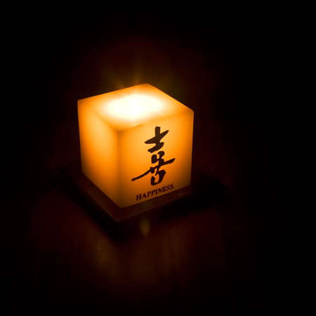 Candle with ideograms translated as